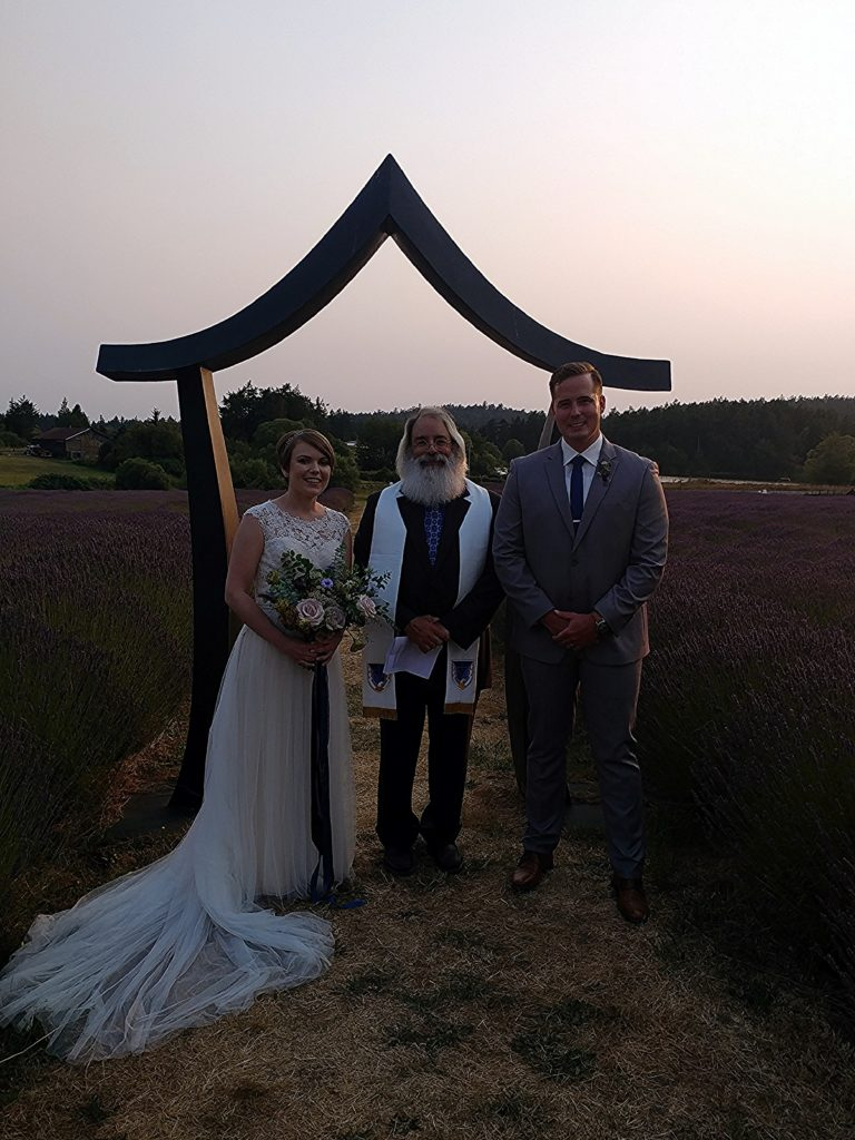 Revernd Jim Beidle sunset elopement in a lavendar field