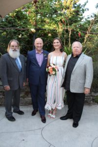 The couple and father of the groom at a Bronze Wedding